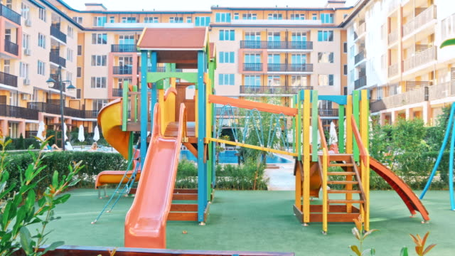 Colorful children playground Colorful children playground, without children outdoor play equipment stock videos & royalty-free footage