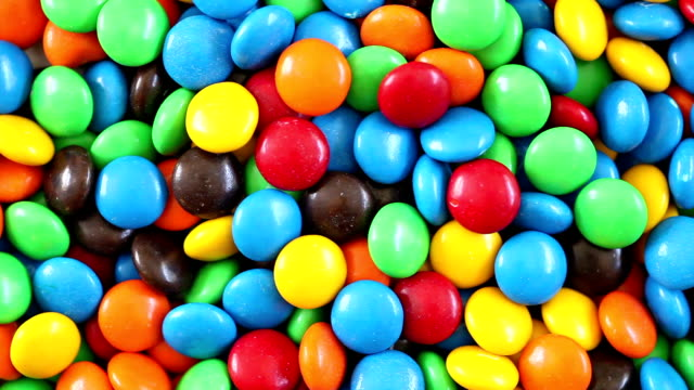 colorful chocolate candy - 3 videos in 1 (full hd) - junk food stock videos and b-roll footage