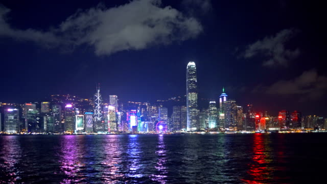 Colorful city lights of Hong Kong Downtown skyline and Victoria Harbour. Financial district and business centers in smart city, technology concept. skyscraper and high-rise buildings at night.