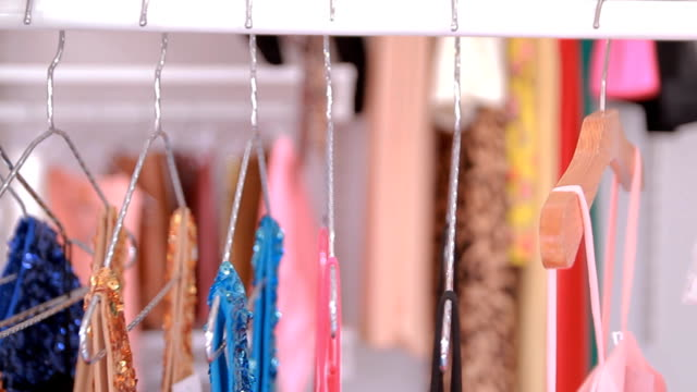 Colorful Clothes on a coat rack video