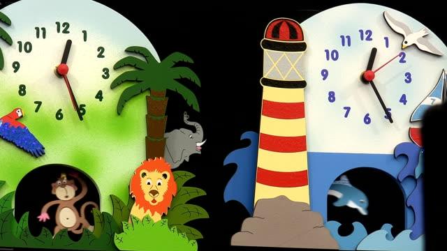 Colorful colourful children pendulum clocks video