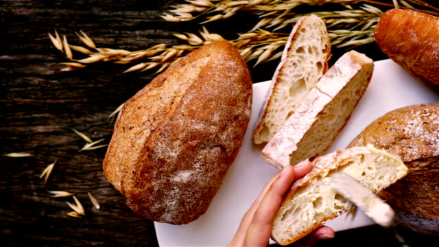 Colorful Cuisine Freshly baked traditional Italian Cibatta bread cut in slices on a wooden table bread stock videos & royalty-free footage