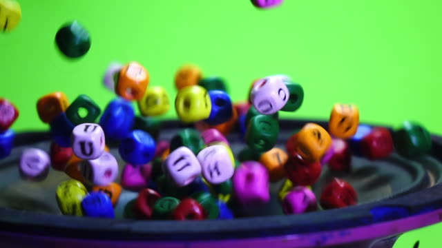 Colorful dice exploding on speaker slow motion