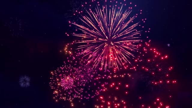 colorful display of fireworks loop animation. - happy 4th of july stock videos & royalty-free footage