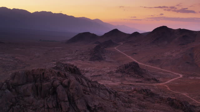 colorful dusk sky over the alabama hills - drone shot - rock formations stock videos & royalty-free footage
