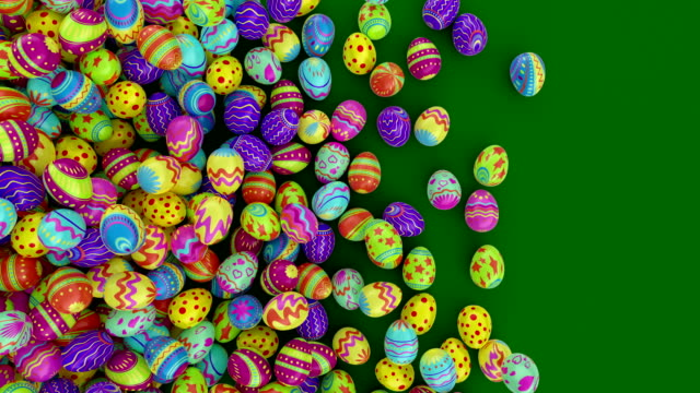 Colorful Easter eggs, fall into the frame and fill it completely. Green background.