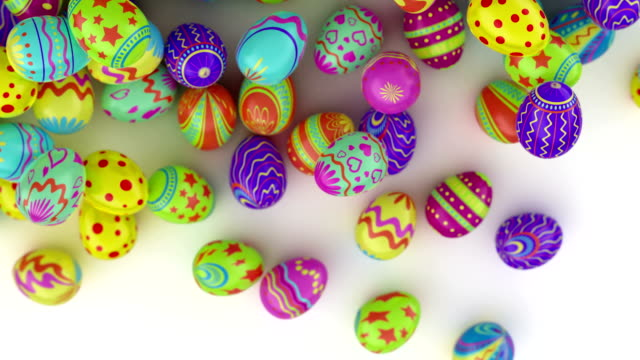 Colorful Easter eggs, fall into the frame and fill it completely. White background. video