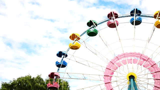Colorful ferris wheel in the city park. video