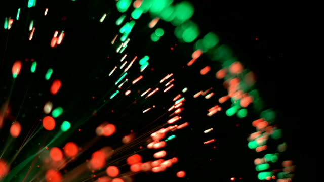 Colorful fibre optic lights and flying particles video