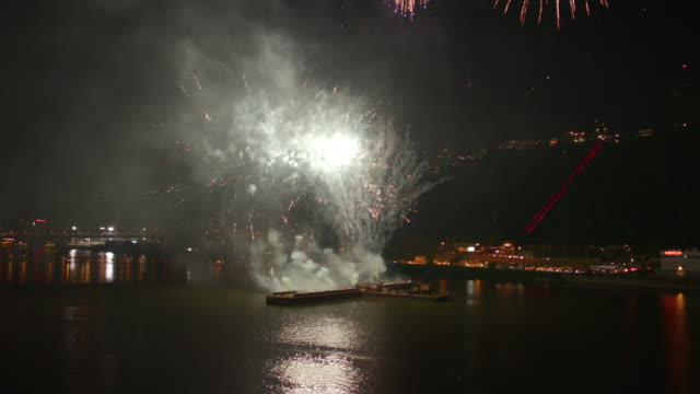 Colorful Fireworks Display Over River from Barge at Night Colorful Fireworks Display Over River from Barge at Night happy 4th of july videos stock videos & royalty-free footage