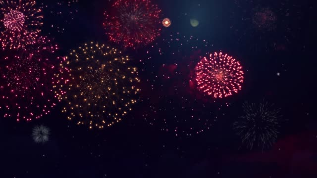Colorful fireworks exploding in the night sky Loop Animation. Colorful fireworks exploding in the night sky Loop Animation. Birthday, Anniversary, Celebration, Holiday, new year, Party, event, celebrations, Invitation, carnival, Christmas, festival, greeting, Diwali, Wedding firework explosive material stock videos & royalty-free footage