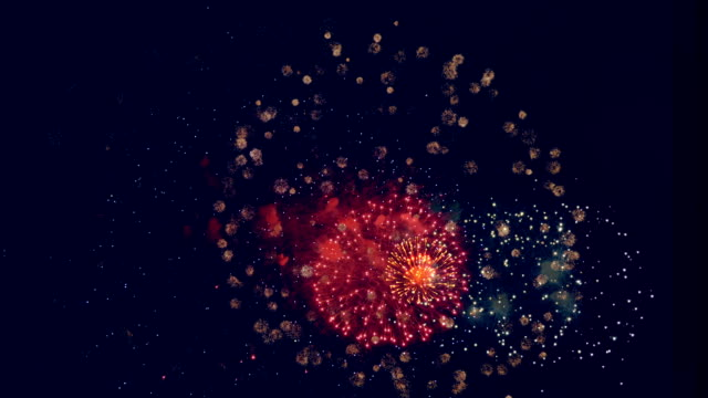 Colorful fireworks in a night sky. Sparkling fireworks crack, during a holiday party. happy 4th of july videos stock videos & royalty-free footage