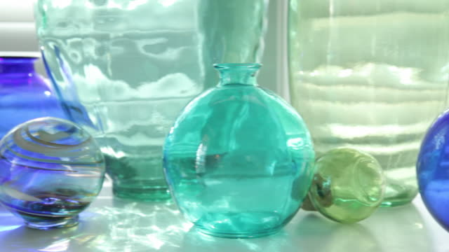 Colorful glass bottles video