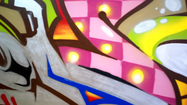 Colorful graffiti mural Close up of beautiful graffiti mural in a classroom mural stock videos & royalty-free footage
