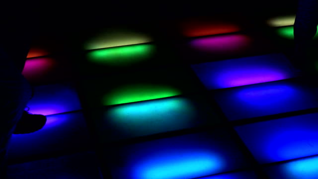 colorful illuminated dance floor in a club - soft focus video stock e b–roll
