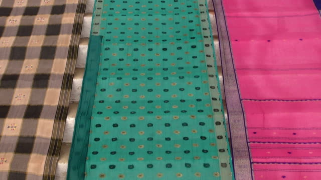 colorful indian sari silk background colorful indian sari silk on Varanasi staircase background sari stock videos & royalty-free footage