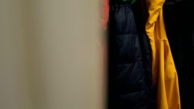 colorful jackets on coat rack - abiti pesanti video stock e b–roll