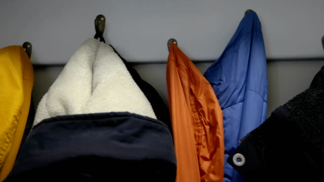 Colorful jackets on coat rack video