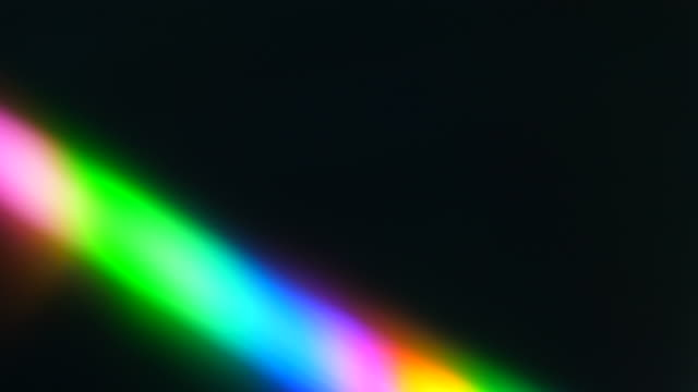 Colorful Light Beam and Ray on Black Background. Abstract Background Rainbow on CD. Beautiful Color Lens Light Rainbow Beam for Movie and Cinema at Night. Prism Separating Ray Into Colors of Spectrum. Colorful Light Beam and Ray on Black Background. Abstract Background Rainbow on CD. Beautiful Color Lens Light Rainbow Beam for Movie and Cinema at Night. Prism Separating Ray Into Colors of Spectrum. prism stock videos & royalty-free footage