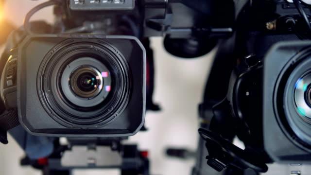 Colorful light spots on three camera lenses. video