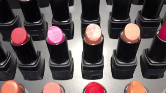 colorful lipsticks - kosmetyczka praca w salonie piękności filmów i materiałów b-roll