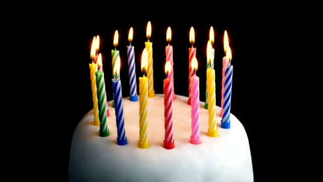 Colorful Lit Candles On Birthday Cake video