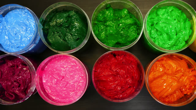 colorful of ink for print on tee shirt in transparent cans video