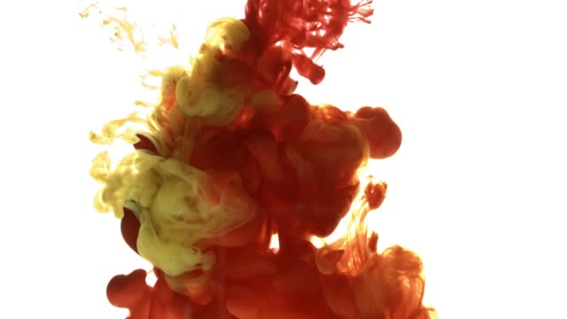 colorful paint cloud spraying in water on white background. - arancione video stock e b–roll
