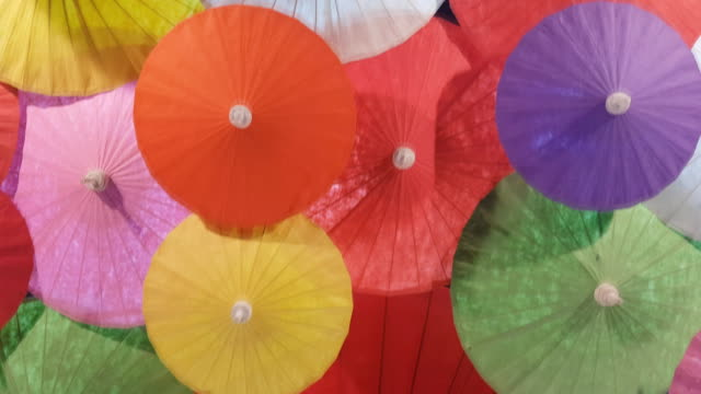 colorful paper hand craft umbrellas, handmade in Chiang Mai, Thailand. Umbrellas, handmade in Chiang Mai, Thailand. painting art product stock videos & royalty-free footage