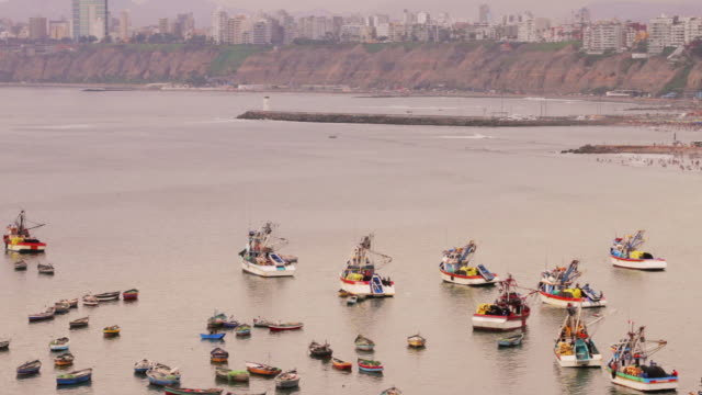 colorful peruvian fishing boats in harbor video