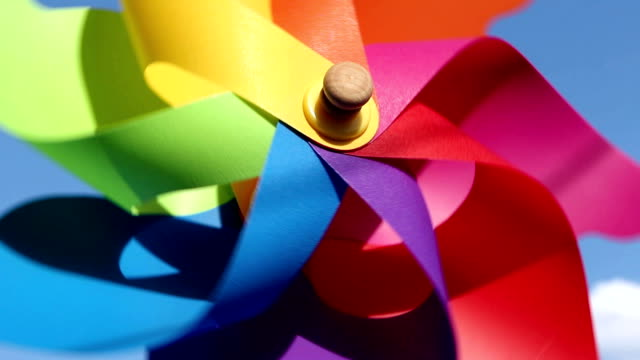 Colorful pinwheel toy against blue sky video