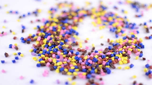 Colorful polymer granules falling video