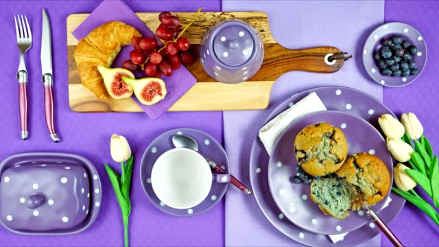 Colorful purple theme breakfast brunch table setting flatlay stop motion. Modern bright colorful purple theme morning breakfast or brunch table setting, flat lay stop motion. table top view stock videos & royalty-free footage