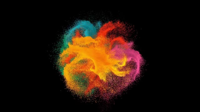 Colorful rainbow holi paint color powder explosion isolated at black background