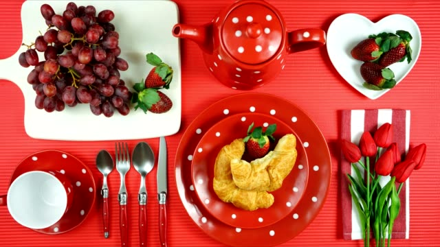 Colorful red theme breakfast brunch table setting flatlay stop motion. Modern bright colorful red theme morning breakfast or brunch table setting, flat lay stop motion. table top view stock videos & royalty-free footage