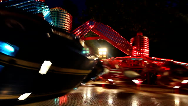 colorful spinning wheel in amusement park at night - roller coaster stock videos & royalty-free footage