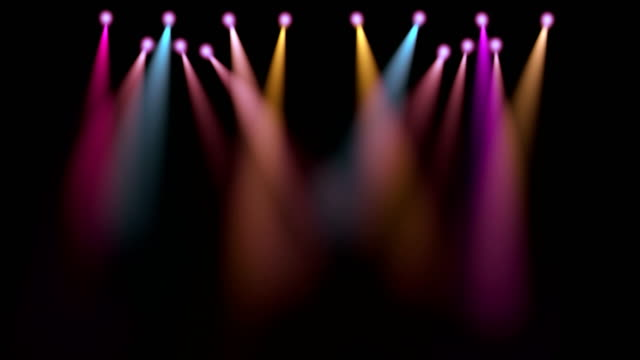 colorful stage lights movement, projectors in the dark, purple,red,blue soft light spotlight strike on black video