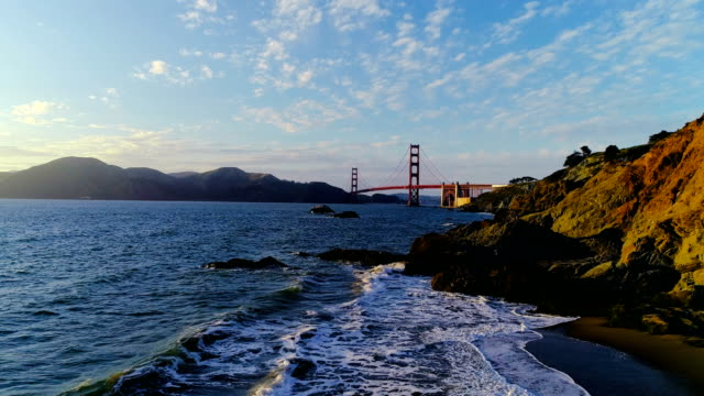 SLOW MOTION: Colorful Sunset at Baker's Beach with Golden Gate Bridge in San Francisco , California
