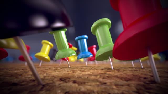 Colorful thumb tacks on a cork board. Loopable CG. video