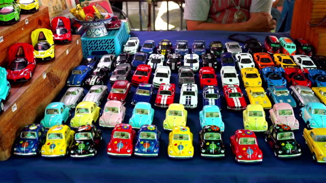 colorful toy cars at shop in thailand - giocattolo video stock e b–roll