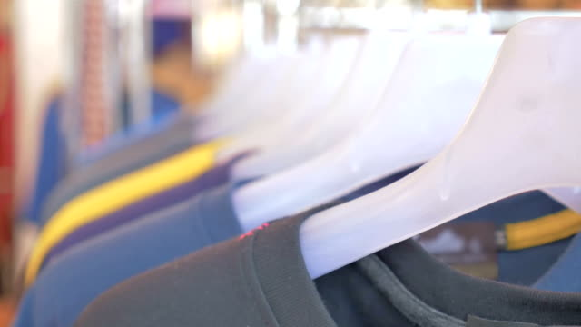 Colorful T-shirts on a coat rack,Motion focus concept video