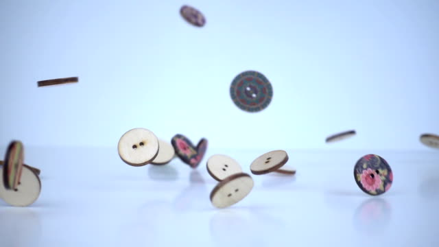 colorful wooden buttons falling on the floor in slow motion. - cucire video stock e b–roll