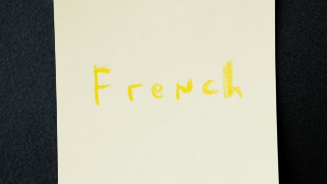 Colorful written word stop motion. Speaking French course concept. video