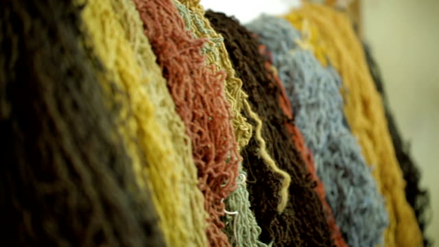 Colorful yarn of sheep wool for weaving carpet, manufacture industrial textile video