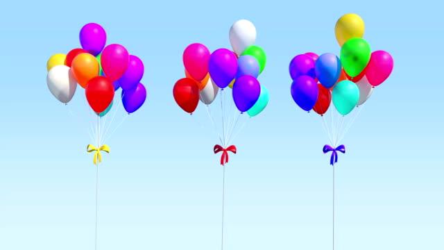 colorfull balloons blowing - blue yellow band bildbanksvideor och videomaterial från bakom kulisserna