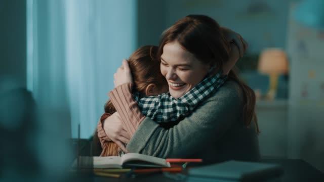 vídeos de stock e filmes b-roll de coloring and hugging - help