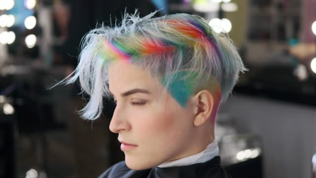 Coloring hair in a barbershop. Multicolored dyeing. Coloring hair in a barbershop. Multicolored dyeing. A short pixie haircut. blue hair stock videos & royalty-free footage
