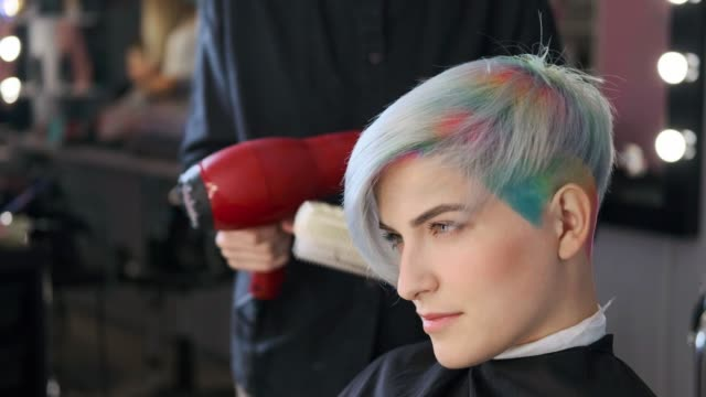 Coloring hair in a barbershop. Multicolored dyeing. Coloring hair in a barbershop. Multicolored dyeing. A short pixie haircut. hairstyle stock videos & royalty-free footage