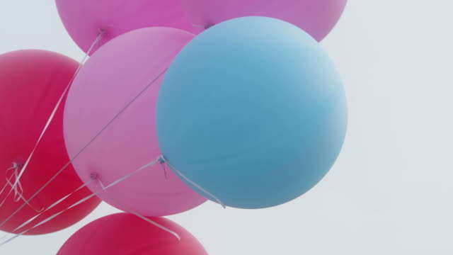 colourful big balloons flying in the air with clear sky video