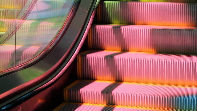 Colourful escalator. Closeup. video